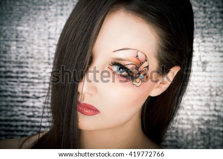 Picture of cretive makeup on silver background - stock photo