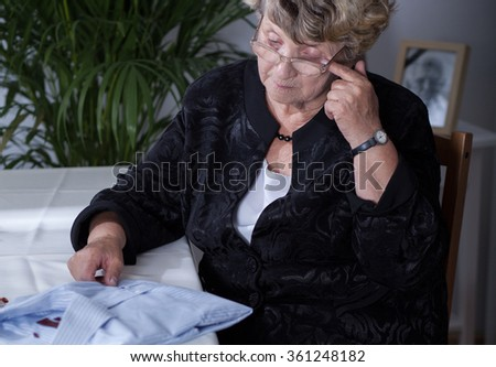 Picture of depressed widow missing her husband - stock photo