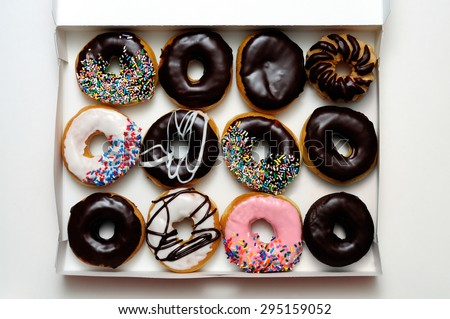 Picture of donut box with one dozen assorted doughnuts - stock photo