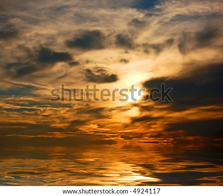Picture of dramatic sunset sky above ocean - stock photo