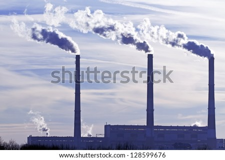 picture of factory pipes with smoke - stock photo