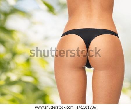 picture of female legs in black bikini panties - stock photo