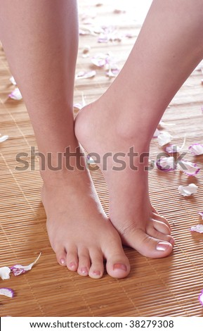 Picture of female legs in spa atmosphere - stock photo