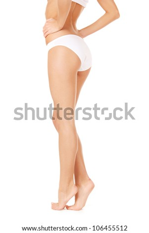 picture of female legs in white bikini panties - stock photo
