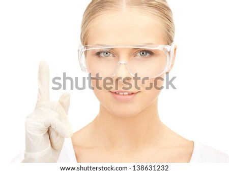 picture of female scientist in eyeglasses holding finger up - stock photo