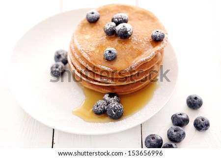 Picture of few pancakes with blackberries and sugar - stock photo