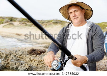 Picture of fisherman fishing with rods - stock photo