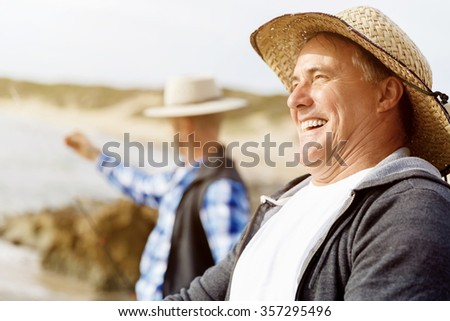 Picture of fishermen fishing with rods - stock photo