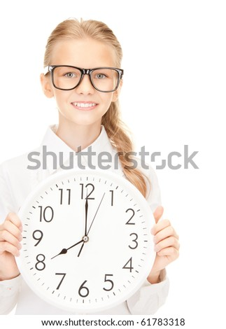 picture of girl holding big clock over white