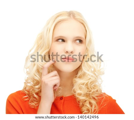 picture of girl thinking with finger on her cheek - stock photo