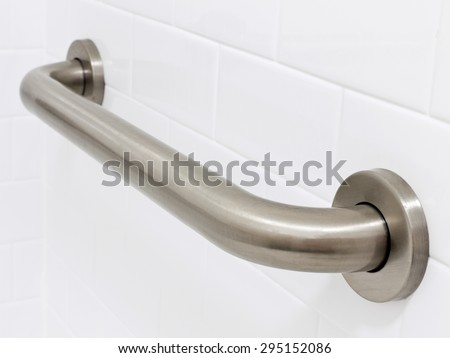 Picture of grab bar handrail in a hotel handicapped disabled access bathroom - stock photo