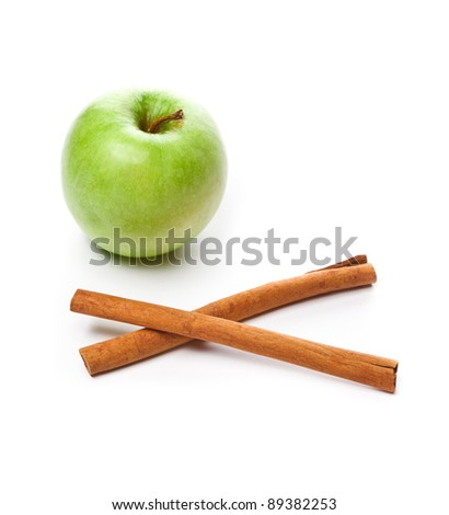 Picture of green apple and cinnamon isolated on white