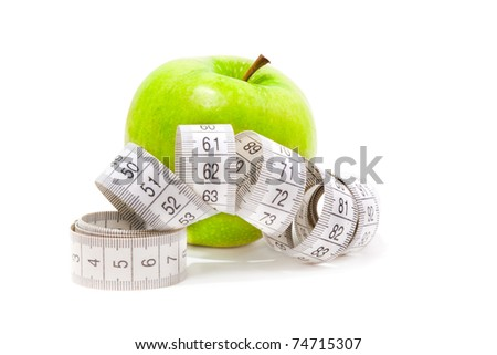 Picture of green apple and measure tape isolated on white