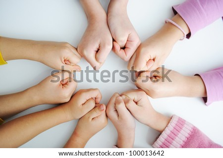 Picture of hands to stay together over the table to show solidarity - stock photo