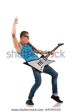 Picture of handsome guitarist in sunglasses isolated on white making a rock gesture - stock photo