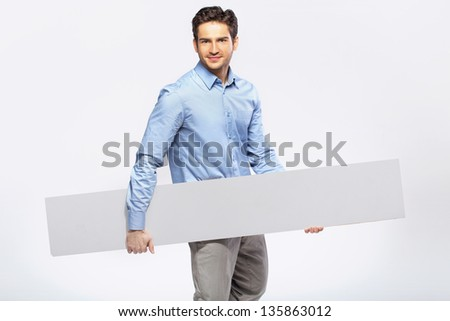 picture of handsome man in suit with a blank board - stock photo