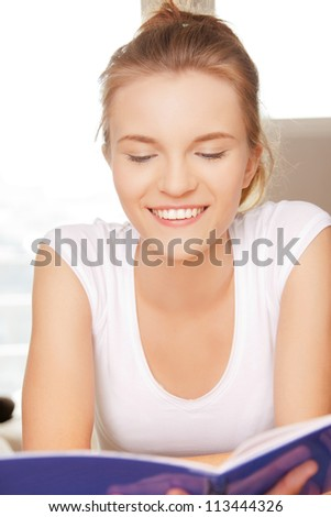 picture of happy and smiling teenage girl with big notepad