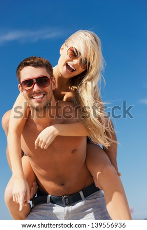 picture of happy couple having fun on the beach. - stock photo