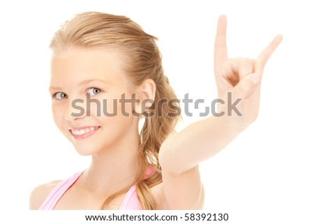 picture of happy girl showing devil horns gesture - stock photo