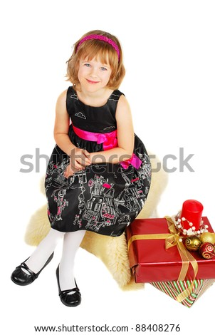 Picture of happy little girl sitting with gift christmas box happy and smile. Isolated on the white background.