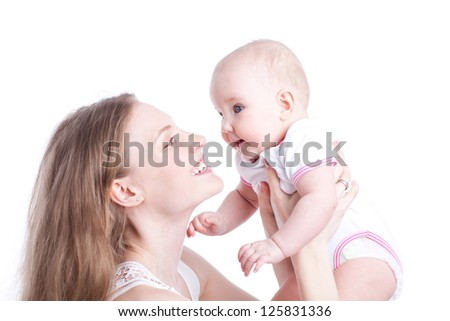 picture of happy mother playing with sweet baby girl over white - stock photo