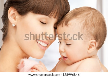 picture of happy mother with adorable baby - stock photo