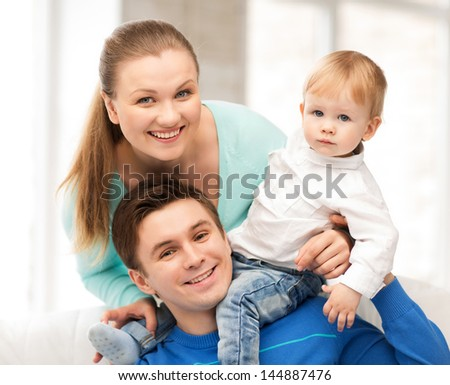 picture of happy parents playing with adorable baby - stock photo