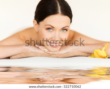picture of happy relaxed woman in spa salon - stock photo