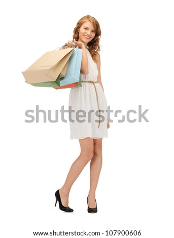 picture of happy teenage girl with shopping bags - stock photo