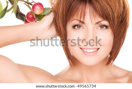 picture of happy woman with apple twig - stock photo