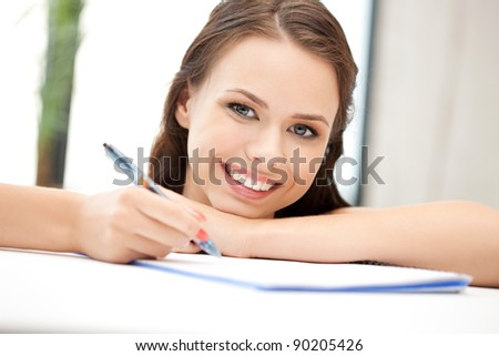 picture of happy woman with big notepad - stock photo