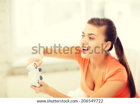 picture of happy woman with joystick playing video games - stock photo