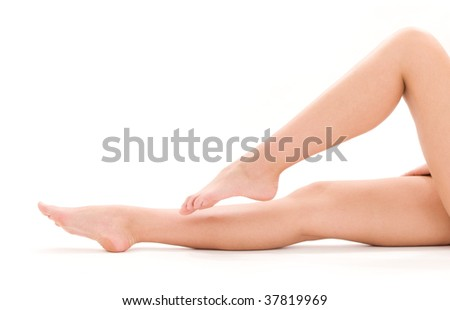 picture of healthy naked woman legs over white