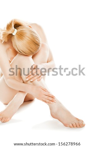 picture of healthy naked woman sitting in studio over white - stock photo