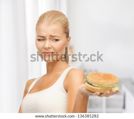 picture of healthy woman rejecting junk food - stock photo