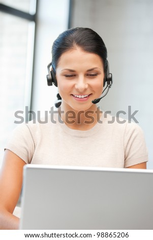 picture of helpline operator with laptop computer. - stock photo
