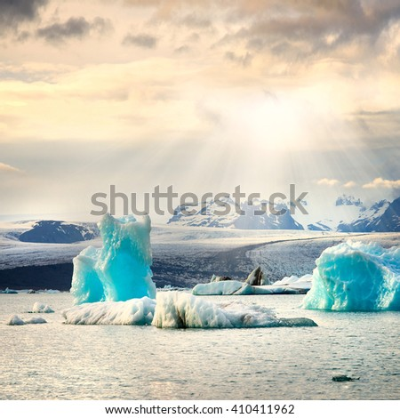 picture of icelandic glacier and glacier lagoon at sunset - stock photo