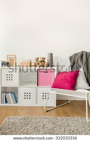 Picture of infant room with new design white cabinet - stock photo