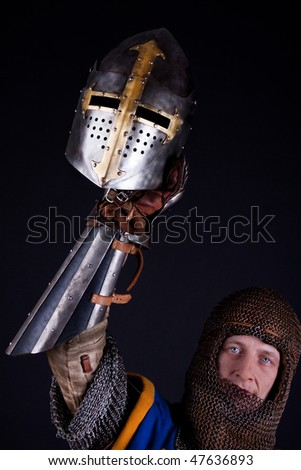 Picture of knight with helmet in hand - stock photo