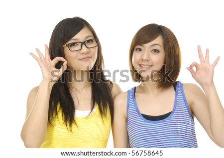 picture of lovely Asian University student showing ok sign - stock photo