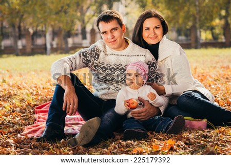 Picture of lovely family in autumn park, young parents with nice adorable kids playing outdoors, five cheerful person have fun on backyard in fall, happy family enjoy autumnal nature - stock photo
