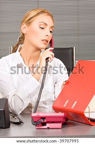 picture of lovely girl with phone in office