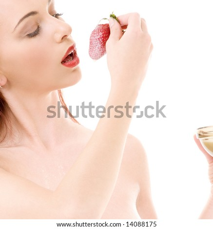 picture of lovely girl with strawberry over white - stock photo