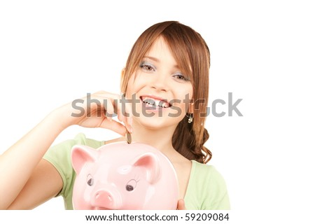 picture of lovely teenage girl with piggy bank and coin - stock photo