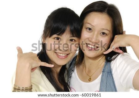 picture of lovely two woman making a call me