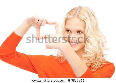 picture of lovely woman creating a frame with fingers - stock photo
