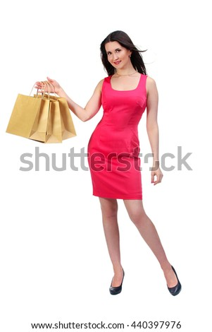 Picture of lovely woman in red dress with biodegradable shopping bag. Isolated on white.