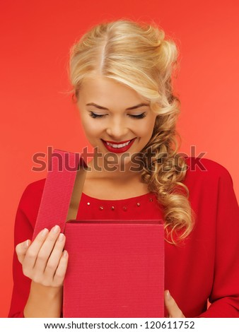 picture of lovely woman in red dress with opened gift box - stock photo