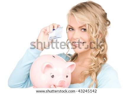 picture of lovely woman with piggy bank and money - stock photo