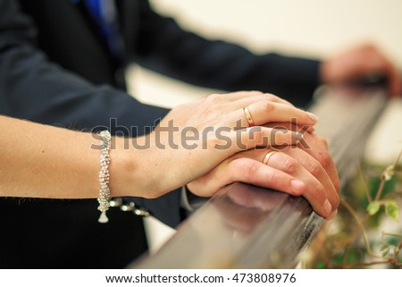 picture of man and woman with wedding rings. Hands with wedding rings